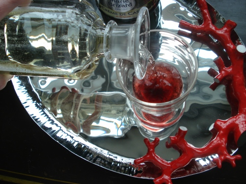 I recommend about 2 tsp liqueur, but you can add more wine to cut the sweetness.