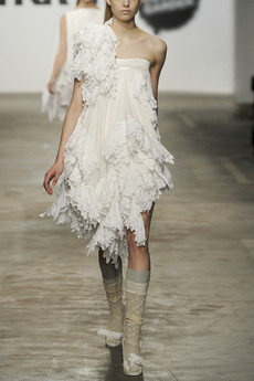 Silk-fringed dress on the runway.