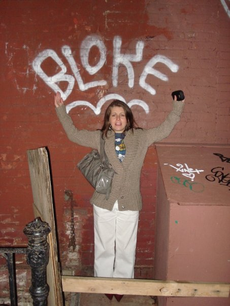 A bloke for all season: Amanda D. Murphy attends a concert in lower Manhattan in white slacks and a sweater coat.
