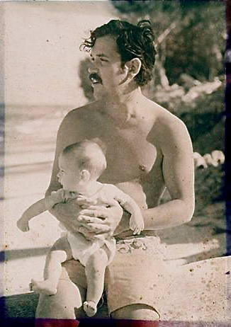 Chuck and Charlie: Magnum P.I. holds his kid on a beach.