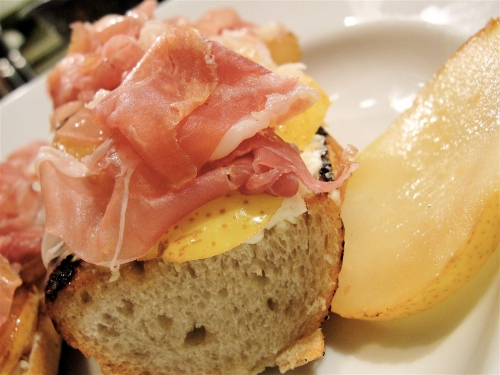 Top with prosciutto and spritz with white truffle oil.